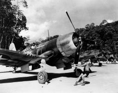 A ground crewman pictured turning over the propeller of an F4U-1 Corsair of Marine Fighting Squadron (VMF) 222 prior to its launching on a mission from Vella Lavella in the Solomon Islands on January 15, 1944, seventy years ago today.