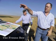 Brent McCaffrey, right, with his father, Robert McCaffrey, left, at the site the 5,200-home Tesoro Viejo development in Madera County. JOHN WALKER — THE FRESNO BEE