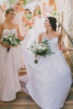 gorgeous bride with her bridesmaids {wearing Paper Crown}