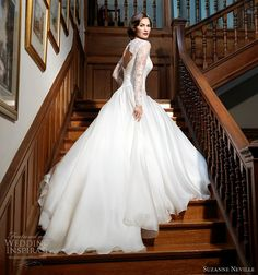 Leading Lady wedding dress in ivory silk organza and french lace, with a full circle skirt, fitted bodice, long sheer lace sleeves, and a high neckline and open back.