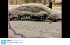 Snowed-in car with #alamw15 tag in snow and tweet: Librarians are pretty tough!