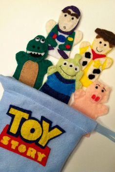 Set of 5 hand sewn felt finger puppets inspired by Disney Pixars Toy Story characters (Woody, Buzz Lightyear, Rex, Pig, and Alien).