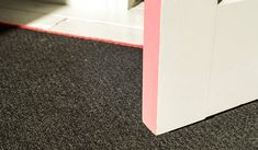 It's all in the detail, colour-coordinated pastel pink trim on the door and carpet.
