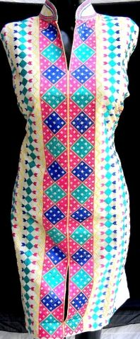 Stunning semi-stitched cotton kurta has machine phulkari work on the front. The kurta is open at the sides and can be stitched to any size/shape. Will look equally good with churidar, salwar or jeans. - See more at: http://giftpiper.com/KhadiPhulkariSemiStitchedKurtaPinkBlue-id-245996.html#sthash.9C2cKMQO.dpuf