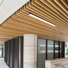 A million dining hub in the heart of London features the first exterior solid wood radial grill ceiling system to be installed in the UK by global architectural products company Hunter Douglas. Wood Slat Ceiling, Baffle Ceiling, Wooden Ceilings, Ceiling Panels, Ceiling Lights, Ceiling Ideas, Hunter Douglas, Types Of Ceilings, Timber Cladding