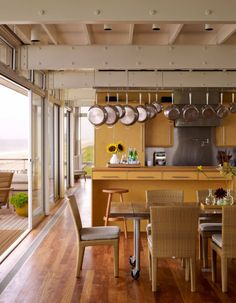 Stelle Architects have designed the Surfside House in Bridgehampton, New York. (Table on Wheels)(Steel Beams)