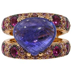 Tanzanite Sapphire Ruby Gold Ring | From a unique collection of vintage cocktail rings at https://www.1stdibs.com/jewelry/rings/cocktail-rings/