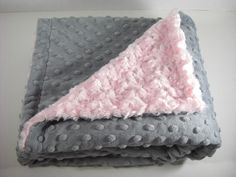 Adult Size Minky Blanket in Light Pink Swirl and Charcoal Gray Minky Dot Monogram Included. $98.50, via Etsy.