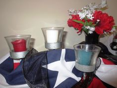Memorial Day - Obvious color theme here, I just worked some American flag bunting around the candles.  The vase is full of Flanders poppies. Due to the extent of ground disturbance in warfare during World War I, poppies bloomed in between the trench lines of the Western front. During the 20th century, the wearing of a poppy on Memorial Day became very popular.  I added the black ribbon to remind me that today is a day to remember the fallen and why I get to live in the best country in the…