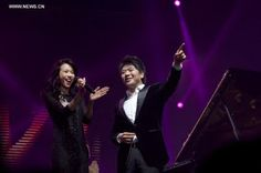 ianist Lang Lang and singer Karen Mok perform during a new year concert in Tianji, December 30, 2012.