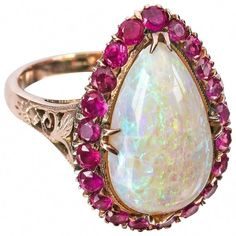 For Sale on - Vintage rose gold 14 kt large teardrop opal ruby ring. High polish rose gold mounting has open scroll work on either side of pronged setting. Ruby Ring Vintage, Vintage Jewelry, Vintage Rings, Round Diamond Ring, Diamond Wedding Rings, Opal Jewelry, Fine Jewelry, Jewelry Rings, Jewlery