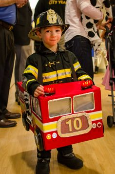 what a great fireman and firetruck costume!