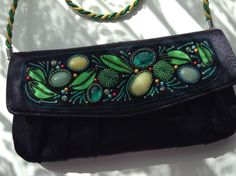 Hand embroidered clutch by Dee