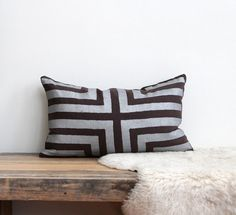 Doha lumbar pillow cover hand printed in metallic silver on brown organic hemp 12x21