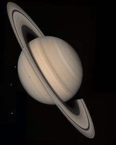 Saturn and Three Moons Credit: NASA/JP ~ Saturn and three moons, Tethys, Dione and Rhea, seen by a Voyager spacecraft on August 4, 1982, from a distance of 13 million miles.