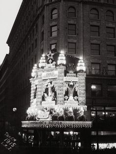 Houghton & Dutton in Boston were using electric lights to decorate their Christmas facades. This 1915 photo shows the brilliant entryway tha...