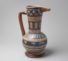 Pitcher Date: ca. 1430 Geography: Made in probably Manises, Valencia, Spain Culture: Spanish Medium: Tin-glazed earthenware Dimensions: Overall: 18 3/8 x 9 in. (46.7 x 22.9 cm)