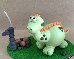 Toupo de bolo dinossauro