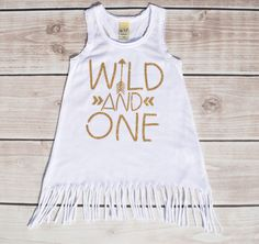 This fringe dress makes for a perfect first birthday outfit for your little girl. First birthday outfit girl, birthday dress, wild and one, glitter birthday shirt, girl birthday shirt,one, 1st birthda