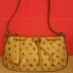Vintage Dooney & Bourke bag (Authentic) Dooney & Bourke bag * with all leather straps * This bag shows some little signs of wearing but it still has lot of life  left to carry on a * Easy like a Sunday morning bag * Stunning and fun * Dooney & Bourke Bags Mini Bags