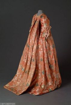 Back view, robe à la francaise, 1750-1780. Orange silk brocaded with multicoloured floral sprays.