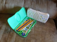 Operation Christmas child - pencil cases. Upcycled mini baby wipes containers.
