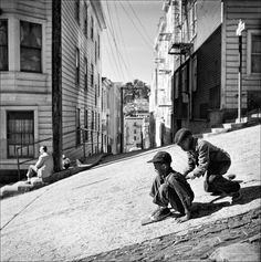 Children street sledding down steep hill, North Beach, San Francisco, 1952. By Fred Lyon.