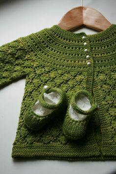 Ravelry: lucille baby cardigan (free pattern) knitted, but I could do something similar with crochet