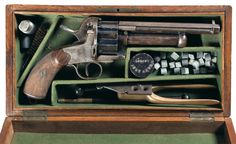 LeMat pinfire revolver    Designed by Eugène Jean Alexandre Le Mat in 1856, manufactured in Liège, Belgium between 1863 and 1865, serial number 3214.  12mm pinfire 9-shots cylinder revolving around a 20 gauge percussion 'grapeshot' barrel firing a three parts lead projectile. The selector switch flips down to hit the percussion cap of the shotgun barrel.