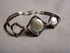 Bracelet with 3 Coin Pearls & 2mm Leather Cord find glass pearls at http://www.ecrafty.com/c-595-glass-pearls.aspx