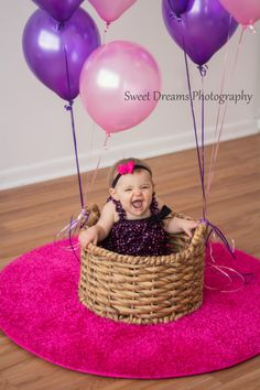 One year old girl birthday indoor photo shoot with balloons and her in a basket. www.facebook.com/sweetdphotos