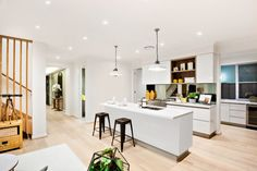 Stylish all-white kitchen counters and cabinets with a snack counter with two stools and contemporary style hanging lamps. White Kitchen Counters, All White Kitchen, Kitchen Island, Kitchen Cabinets, Architectural Digest, Home Renovation, Home Remodeling, Cheap Renovations, Recessed Lighting Fixtures