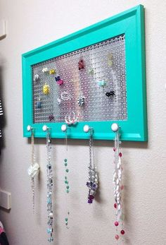 Pick up a frame from the dollar store, grab the spray paint and some drawer pulls and your teen will finally have the organizer she needs for all her baubles.