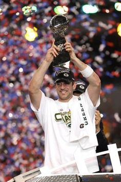 MVP Aaron Rodgers #12 of the Green Bay Packers holds up The Vince Lombardi Trophy after the Green Bay Packers defeated the Pittsburgh Steelers 31 to 25 in Super Bowl XLV at Cowboys Stadium on February 6, 2011 in Arlington, Texas.