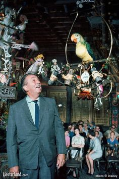 Walt Disney inside the classic Adventureland attraction, the Enchanted Tiki Room.