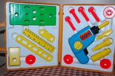 1977 Fisher Price Tool Kit... My brother had this and we all LOVED playing with it!! We had it for many many years.. In fact I think my brother gave it away recently... **sigh**