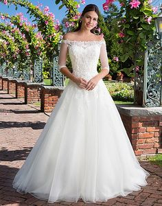 Look like a princess in this beaded Venice lace ball gown featuring an included off the shoulder popover jacket, sweetheart neckline, dropped waistline, and chapel length train. http://www.charlottesweddings.com/for-the-bride/request-appointmen/