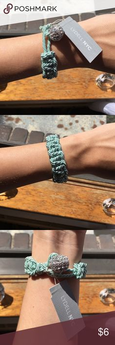 Woven bracelet with crystal accent Light aqua woven bracelet with crystal accent. The crystal bead helps to secure the bracelet around the wrist. Really cute piece, the crystal bead adds the perfect amount of sparkle! lydell NYC Jewelry Bracelets