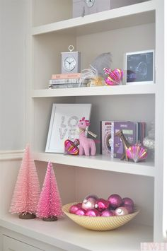 Festive holiday nursery with pink Christmas trees and ornaments.   Honey We're Home