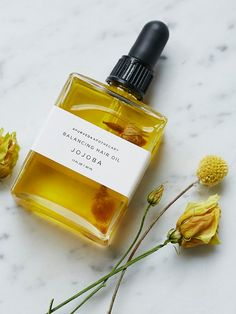 Balancing Hair Oil | Give your locks a luscious treatment with this rich oil blend of all-natural ingredients. Featuring jojoba and sesame oils that condition and strengthen, and healing herbs brahmi and amla for deep nourishing and vibrancy.