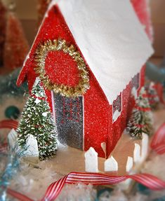 I love christmas houses! Mine are mostly white..thinking I need to break out some paint and glitter!