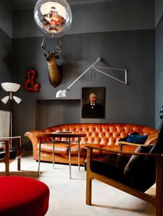 Masculine living space with industrial lighting and large leather sofa