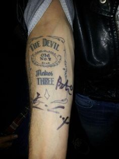 My tattoo signed by the devil makes three love it but terrible tatt