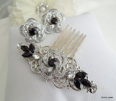 This vintage style hair comb has a rose with clear rhinestones and Jet black Swarosvki rhinestone crystals. Pendant is placed on a filigree and black Swarovski crystals are placed on the sides and in the middle of the pendant for extra sparkle by hand. Hair comb is soldered to filigree. It measures approximately 2 1/2 by 1 wide not including the comb. Rose pendant measures approximately 3/4 in diameter. Leaves are available with clear, sapphire blue, emerald green, peridot, black If you need…