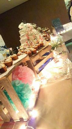 Country Wedding Cake and Cupcakes Table Creates and fresh flowers