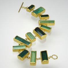 """Petra Class  A 22K and 18K yellow gold wide 88 carat green tourmaline crystal bracelet. Measures 7.5"""" in length."""
