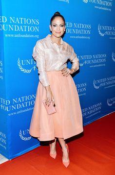 Jennifer Lopez Leather Clutch - Jennifer Lopez finished off her monochratic look with a pink snakeskin clutch.