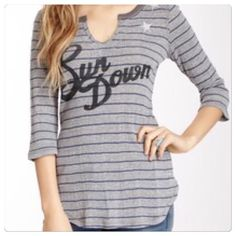 "♣️ Free People we the free thermal sun down top This is a new Free people ""We the Free"" stripe on stripe thermal top. Size medium. Says sun down on front with stars also embroidered on the front. V-neck 3/4 sleeves.  All items are from a clean, smoke free home  We ❤️ offers but will only be considered by using the ""OFFER"" option  Trades  Modeling Free People Tops Tees - Long Sleeve"