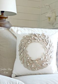 Joss and Main neutral wreath pillow - www.goldenboysandme.com