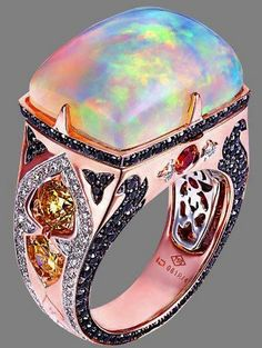 Opal Ring; utilization of colors, gemsones and selection of the colors of gold, setting of the myriad piece of art !